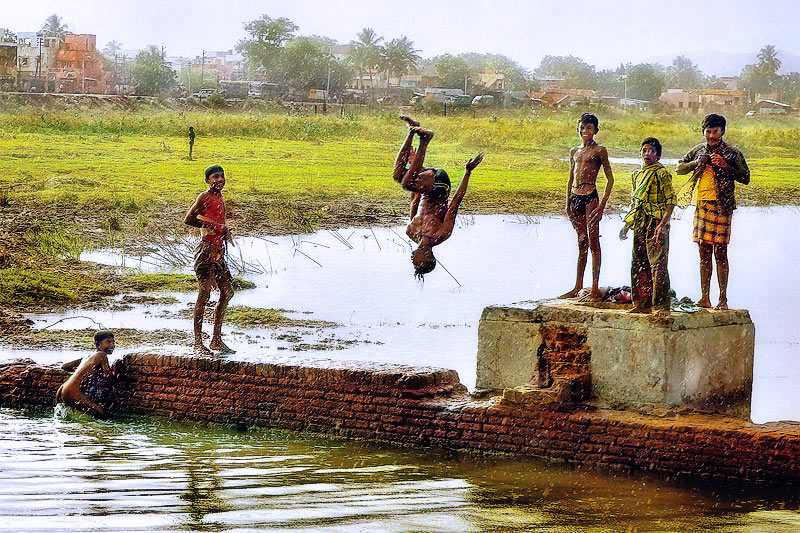 boys jump in river jpg