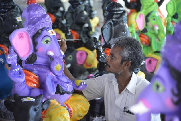 painting ganesh processional sculpture jpg